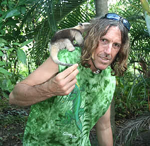 American artist Matthew Child with a baby anteater, being cared for at Rainsong Wildlife Sanctuary
